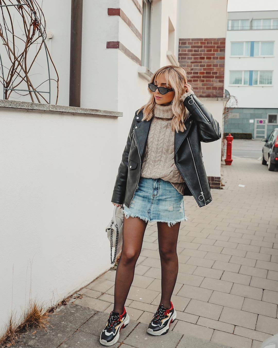 skirt denim skirt sneakers tights black leather jacket turtleneck sweater cable knit white bag