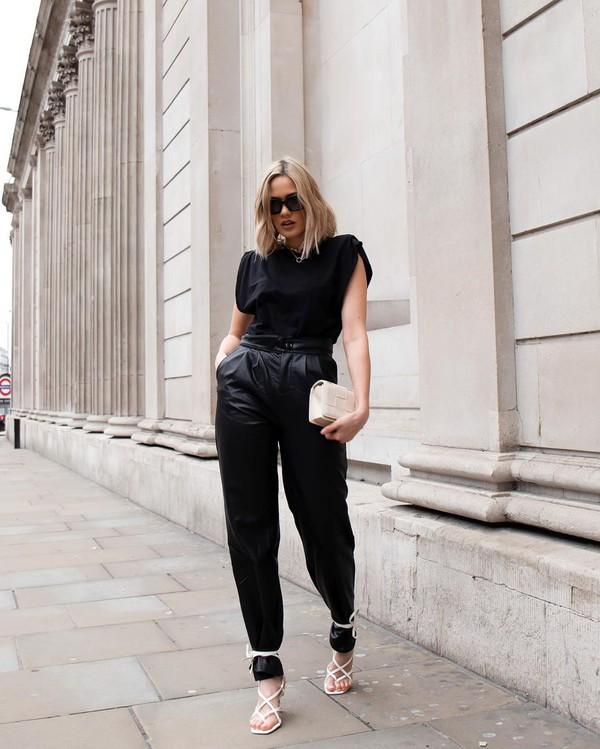 pants black leather pants white sandals black t-shirt handbag